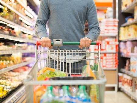 38611885 - detail of a person shopping in a supermarket